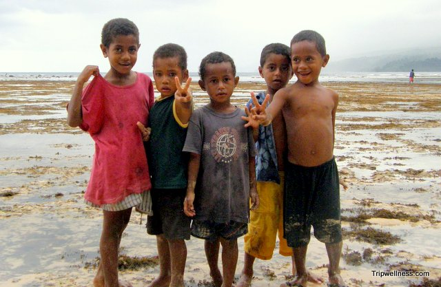 Kids on the beach in Fiji.