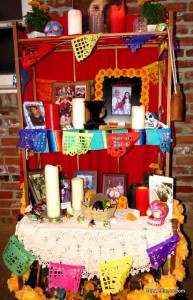 Day of the Dead altar in a shop courtyard. Trip Wellness