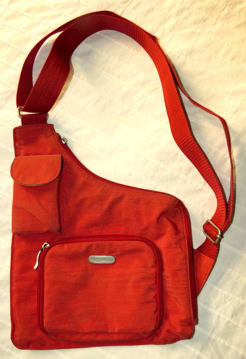 Orange side bag, Trip Wellness