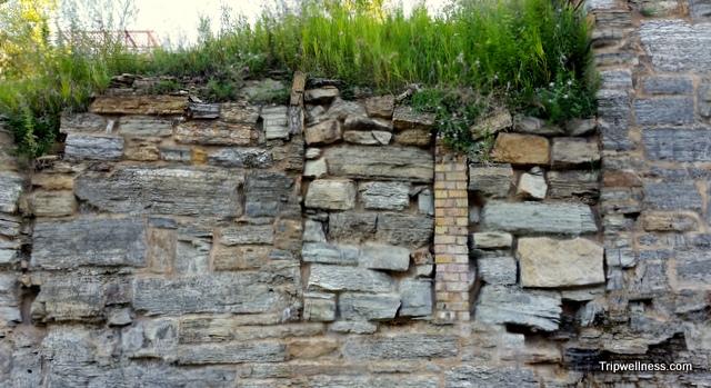 Decades of masonry remain.