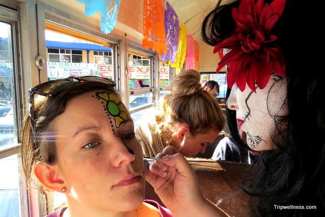 Dia de Muertos face painting inside the Turiste Libre Bus