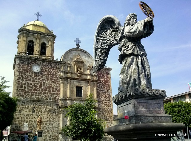 The angel of mercy waits outside the church on the Tequila Trail