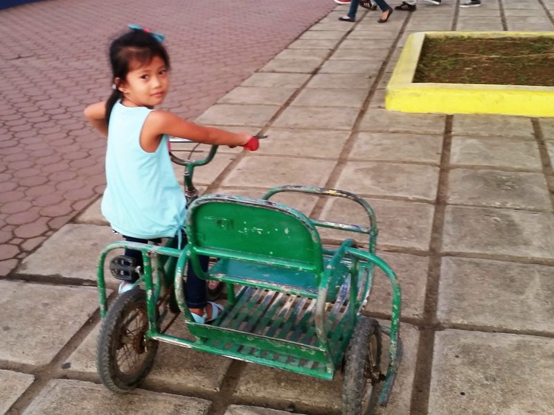 Tricycle toddler on the Puerto Princesa boardwalk
