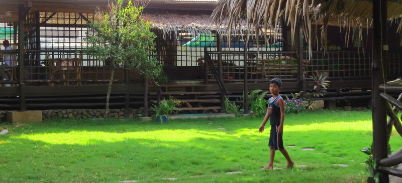 The real Puerto Princesa includes this young boy in the Casa Linda courtyard