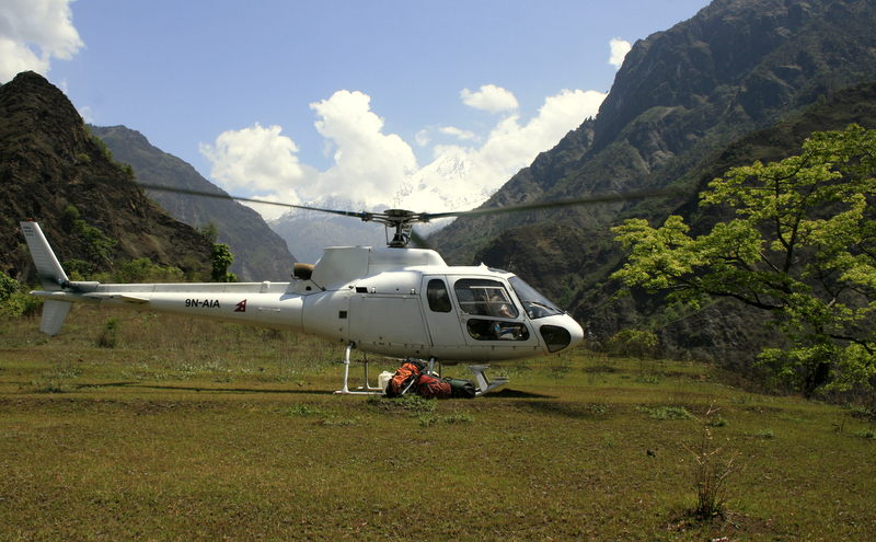 Global rescue lands below base camp.