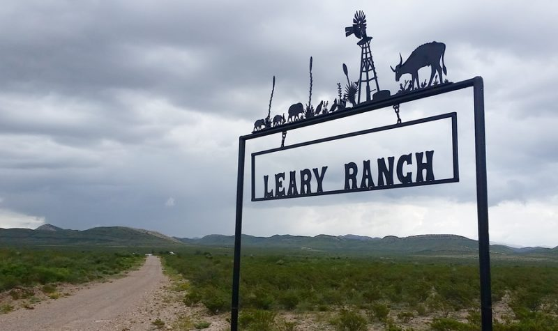 Ranch signs dot the side roads.