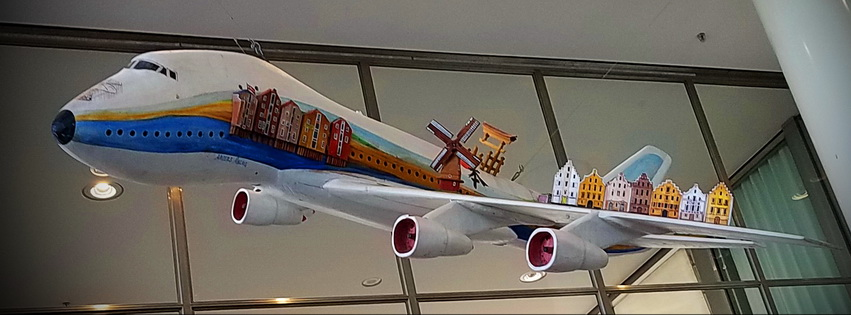 Aiplane art with house sculptures