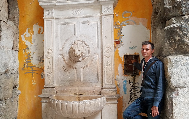 Historian Dino at a fountain inside Diocletian's Palace