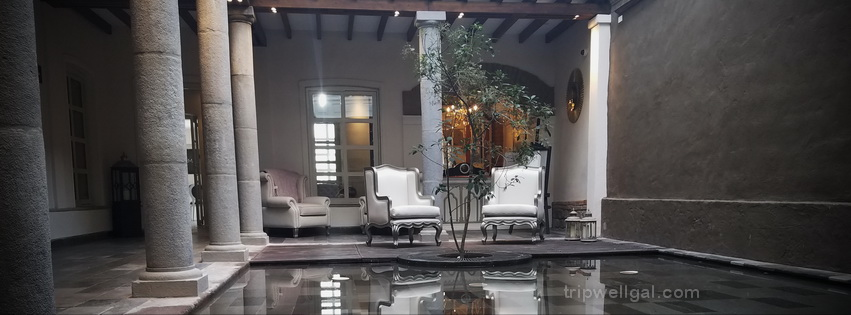 The Illa luxury hotel lobby and it's mirror pool in Quito, Ecuador
