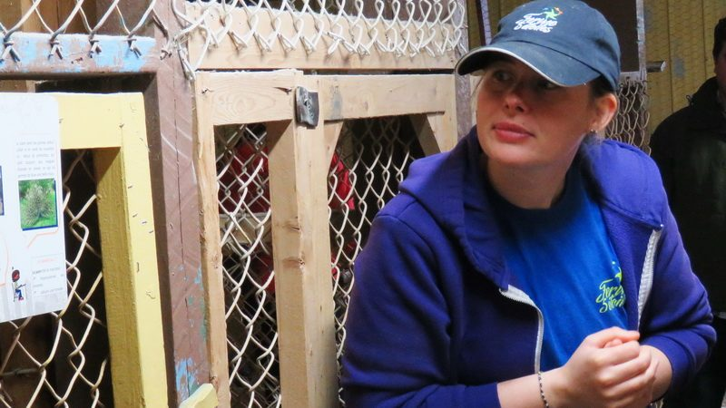 Guide, Delphine Broussard, in the chicken house leads farm vacation guests