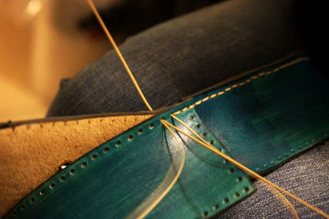 Hand stitching one of the Galen Leather bindings.