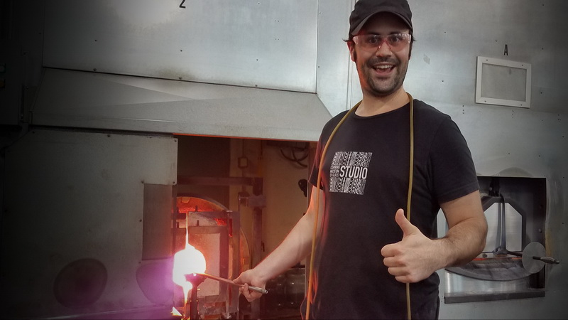 Enthusiastic glass blowing teacher at Corning Museum of Glass