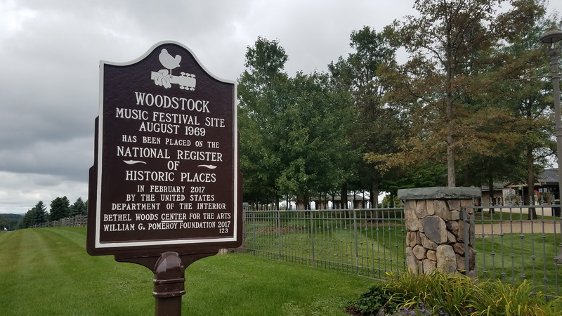 Sign declaring the site of Woodstock Festival is preserved as a National Historic site.
