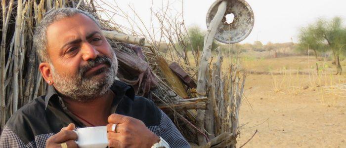Uncle enjoying a chai break in Setrawa