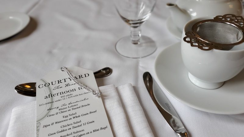 High Tea in Boston Public Library menu and table setting.