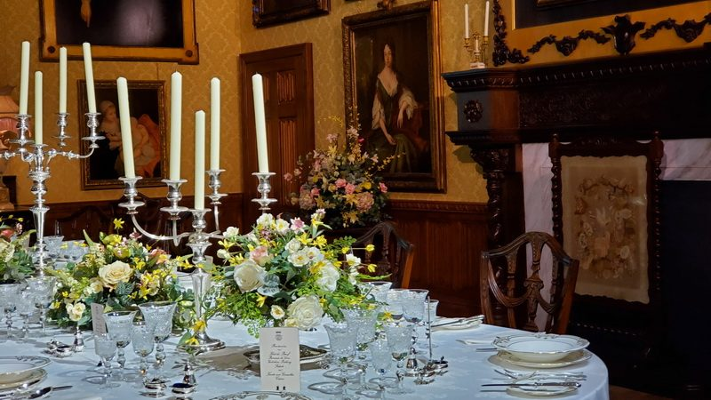 The Downton Abbey dining room set for dinner.