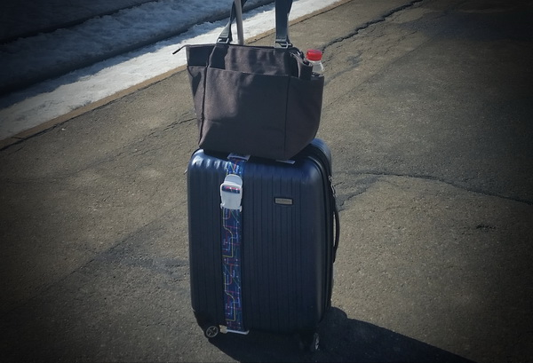 Traveling light with tote and luggge bag