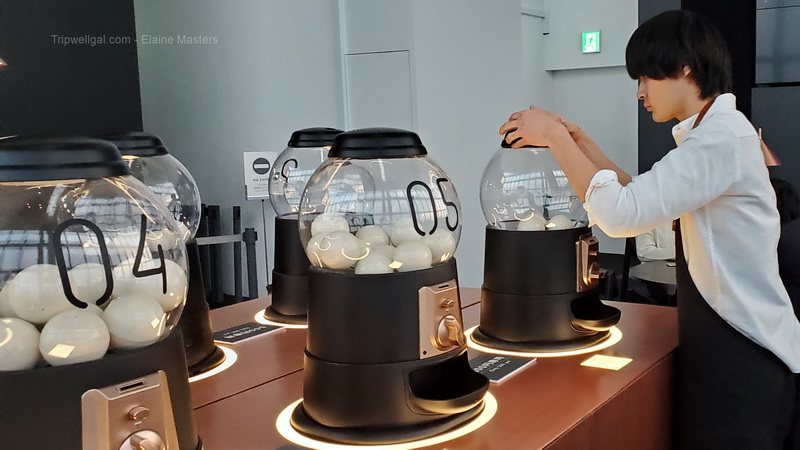 Rappongi view coffee begins in a gumball machine.